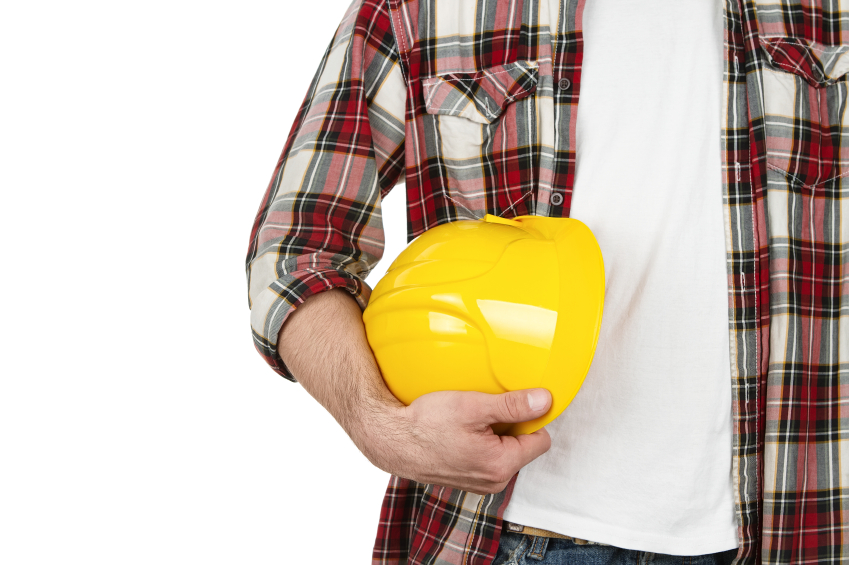Man in construction industry dress with hardhat