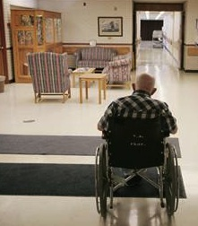 Nursing home facility with elderly male in wheelchair
