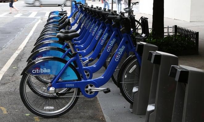 Bikes in a row at bike sharing service kiosk