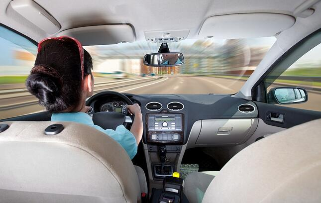 Woman driving car - from passenger perspective