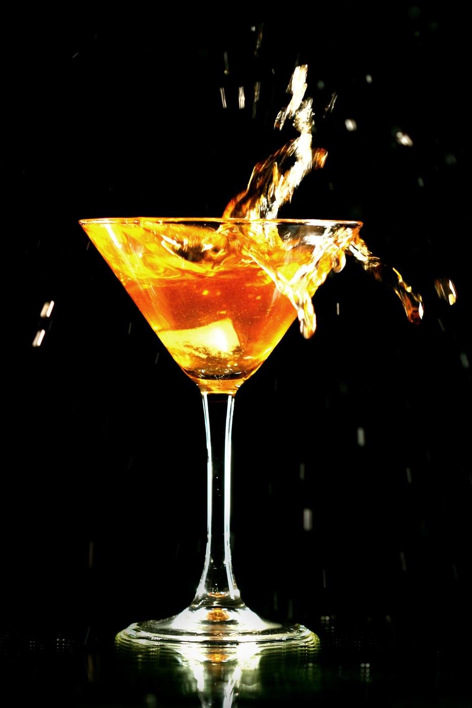 Splashing fruity cocktail in martini glass