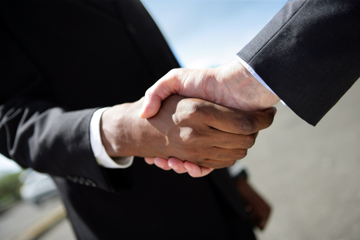 Attorney shaking client's hand