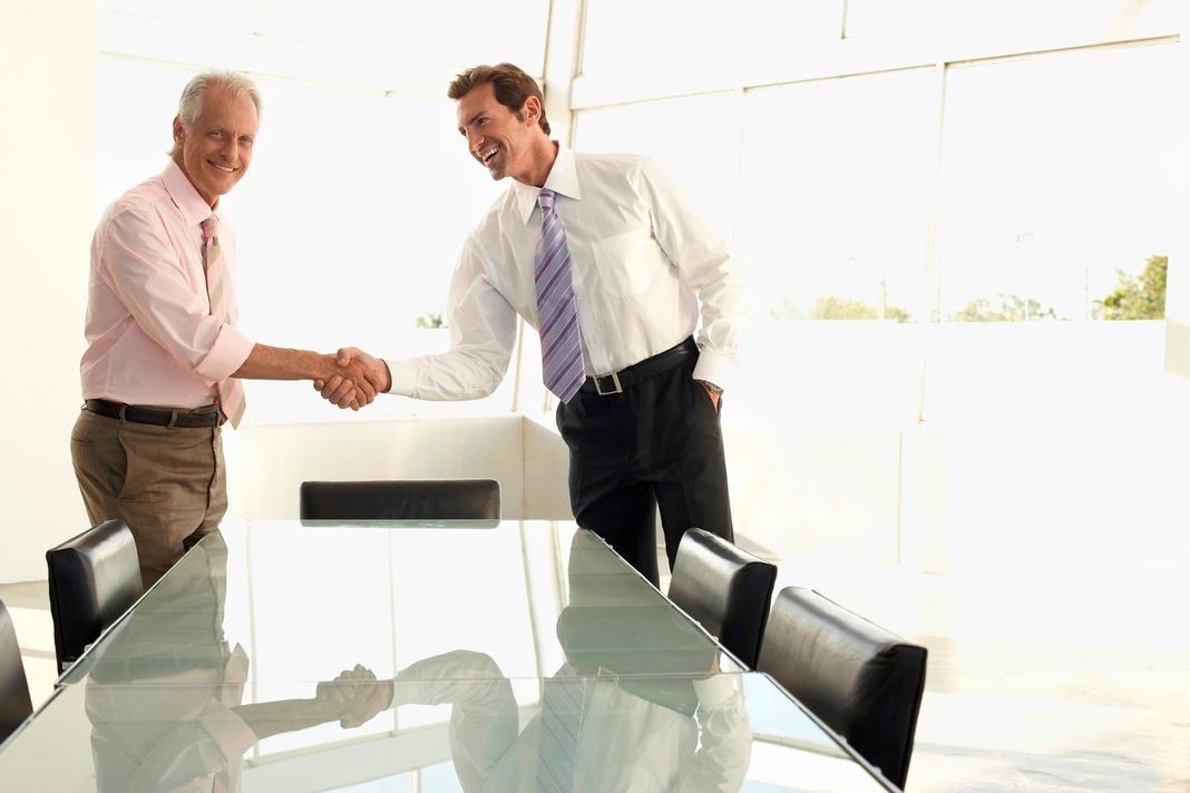 client retaining personal injury attorney handshake