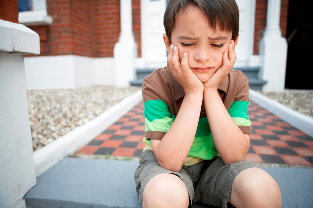 Boy child looking sad