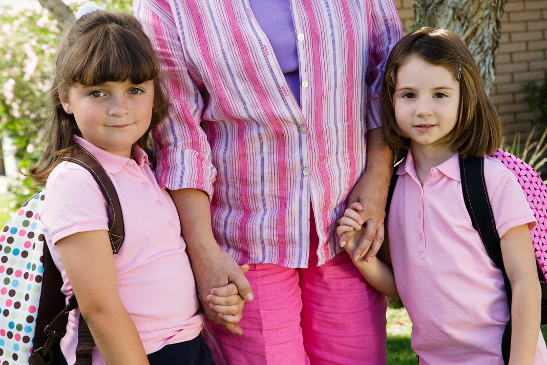 two girls with mother ready for back to school