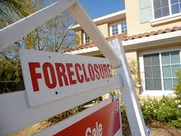 Foreclosure sign in yard of house