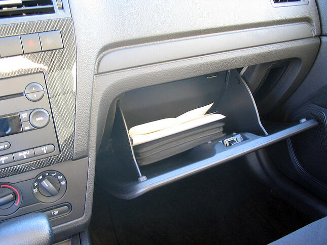 Is it OK to search a glove box in a warrantless auto search?