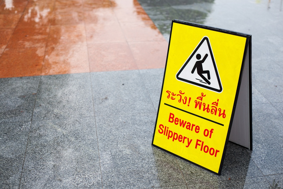 business with slippery floor warning sign