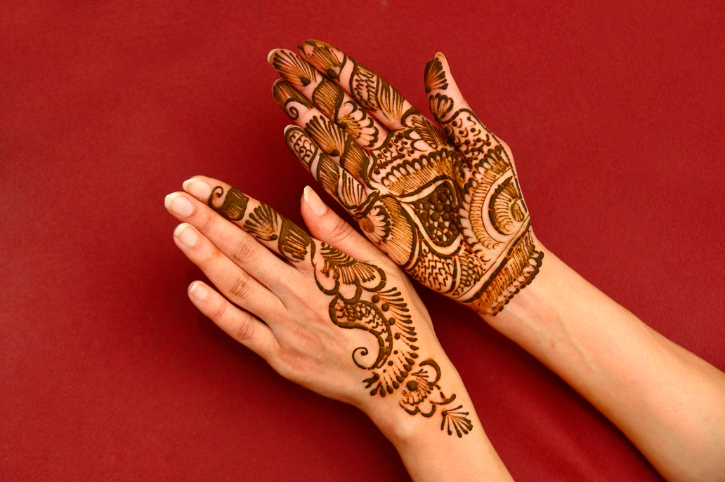 Henna designs painted on woman's hands