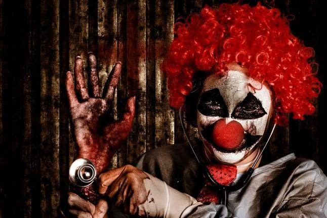 creepy threatening bloody clown