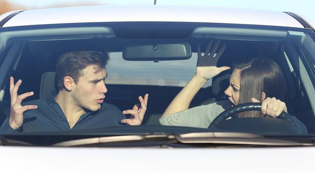 couple arguing in car on vacation