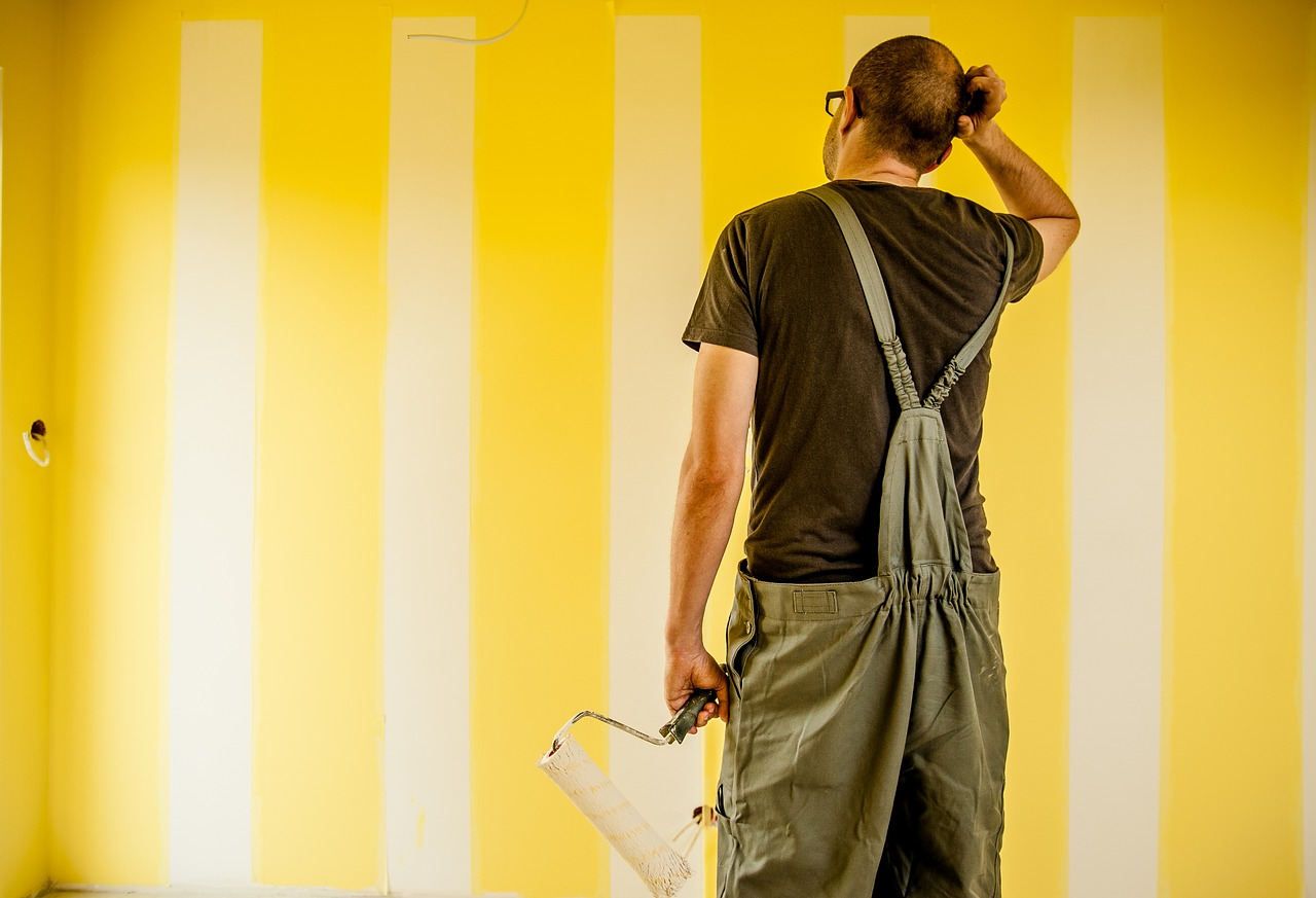 painter working scratching head