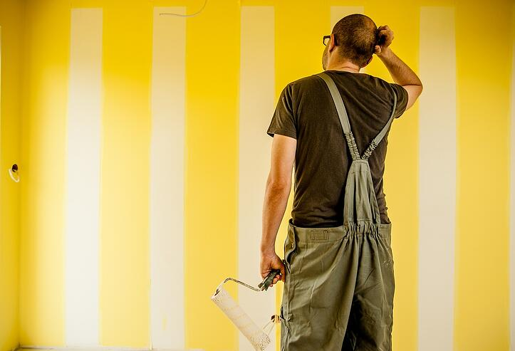 painter working scratching head