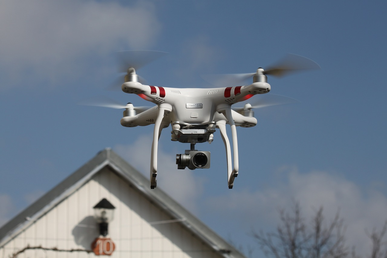 flying a drone with camera over residential buildings