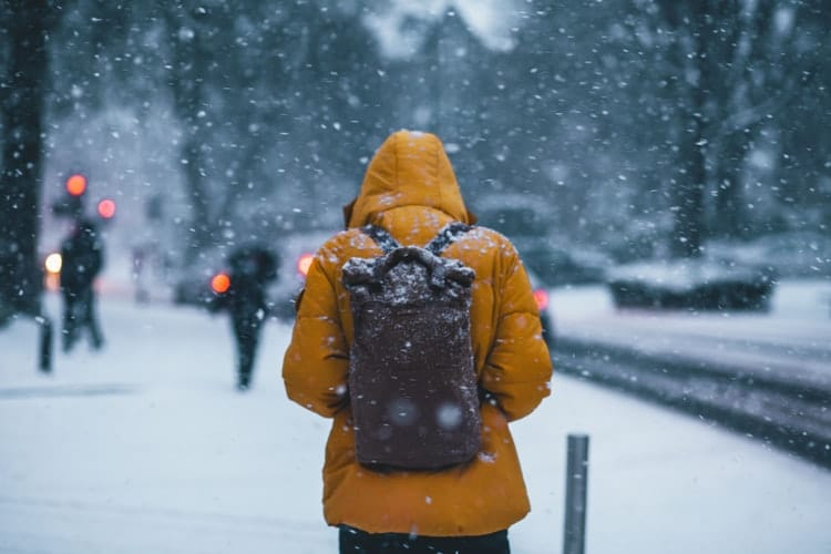 person-in-yellow-jacket-walking-in-snow