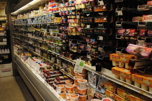 Aisles of an A&P supermarket stocked with food