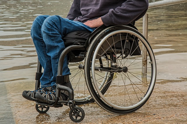 man in wheelchair on the job injury